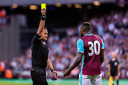 Referee gives Michail Antonio of West Ham yellow card during 2nd Leg football match between West Ham United FC and NK Domzale in 3rd Qualifying Round of UEFA Europa league 2016/17 Qualifications, on August 4, 2016 in London, England.  Photo by Ziga Zupan / Sportida