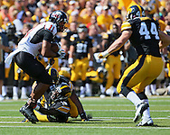 August 31 2013: Northern Illinois Huskies wide receiver Juwan Brescacin (11) tries to pull out of the grip of Iowa Hawkeyes defensive back B.J. Lowery (19) during the first quarter of the NCAA football game between the Northern Illinois Huskies and the Iowa Hawkeyes at Kinnick Stadium in Iowa City, Iowa on August 31, 2013. Northern Illinois defeated Iowa 30-27.