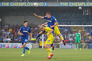 AFC Wimbledon striker Joe Pigott (39) battles for possession with Wycombe Wanderers defender Jack Grimmer (19) during the EFL Sky Bet League 1 match between AFC Wimbledon and Wycombe Wanderers at the Cherry Red Records Stadium, Kingston, England on 31 August 2019.