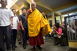 Dalai Lama makes his way out of the temple after a morning prayer ceremony in Dharamsala, India, May 26, 2009.