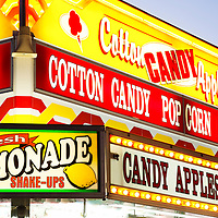 Picture of carnival food concession stand sign with lemonade, cotton candy, popcorn, and candy apples.  Photo is high resolution.