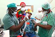 209, Frederic Jean-Jacques, Male, 12 years old, UCL, Before, with Anesthesiologist Observor Godfrey Phiri and Onias Mtalimanja from Malawi.<br /> <br /> Hospital Joseph Ravoahangy Andrianavalona.  Operation Smile's 2015 mission to Antananarivo - Madagascar. 10th -18th April 2015.<br /> <br /> (Operation Smile Photo - Zute Lightfoot)