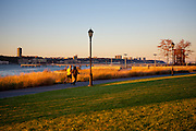 Afternoon light in fall on the waterfront park at Riverside Boulevard, Upper West Side, New York City.