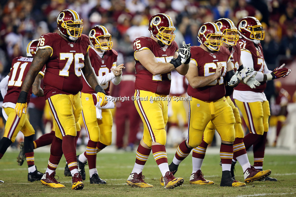 The Washington Redskins offense breaks from the huddle and claps as they head to the line of scrimmage during the 2015 week 13 regular season NFL football game against the Dallas Cowboys on Monday, Dec. 7, 2015 in Landover, Md. The Cowboys won the game 19-16. (©Paul Anthony Spinelli)