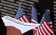 """A vietnam veteran looks for names on the Traveling Vietnam Veterans Memorial, the """"Traveling Wall"""",  during its visit to Petoskey, Michigan."""