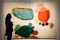 "© Licensed to London News Pictures. 03/09/2013. London, UK. A Sotheby's employee views past ""Brood"" (1962) by Gillian Ayres during the press view for an exhibition of art from the 1960's at Sotheby's in London today (03/09/2013). The exhibition, entitled ""The New Situation: Art in London in the Sixties"" and located at the auction house's New Bond Street building, is open to the public from 4th to the 11th of September 2013. Photo credit: Matt Cetti-Roberts/LNP"