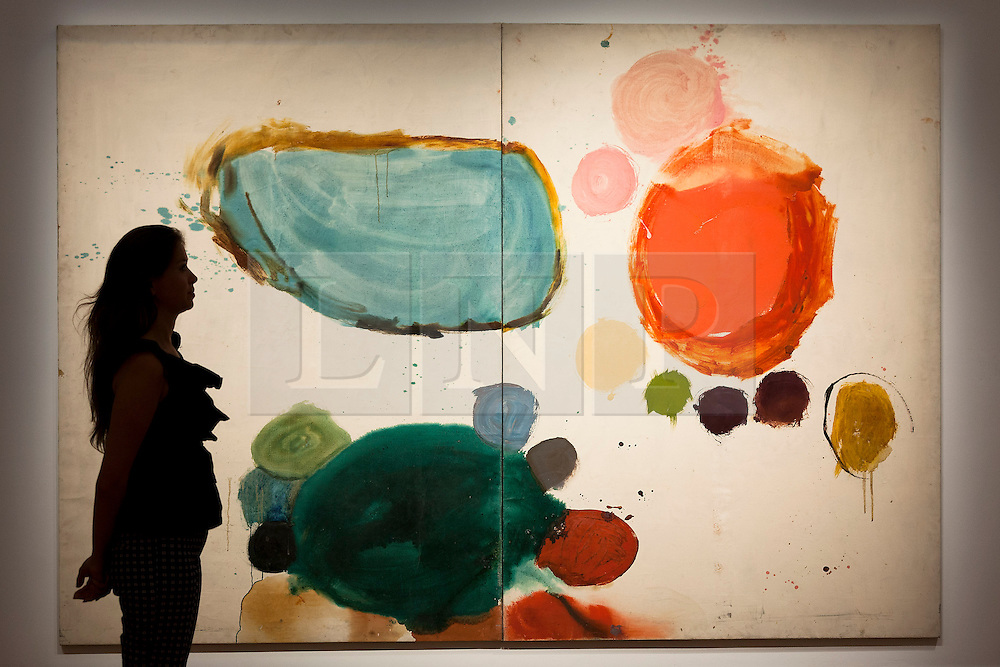 """© Licensed to London News Pictures. 03/09/2013. London, UK. A Sotheby's employee views past """"Brood"""" (1962) by Gillian Ayres during the press view for an exhibition of art from the 1960's at Sotheby's in London today (03/09/2013). The exhibition, entitled """"The New Situation: Art in London in the Sixties"""" and located at the auction house's New Bond Street building, is open to the public from 4th to the 11th of September 2013. Photo credit: Matt Cetti-Roberts/LNP"""