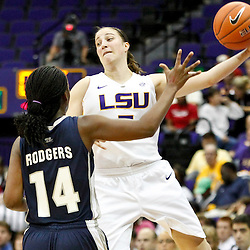 November 16, 2011; Baton Rouge, LA; LSU Tigers guard Jeanne Kenney (5) saves a ball from going out of bounds as Georgetown Hoyas guard Sugar Rodgers (14) defends during the first half of a game at the Pete Maravich Assembly Center.  Mandatory Credit: Derick E. Hingle-US PRESSWIRE