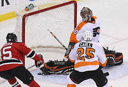 May 6, 2012; Newark, NJ, USA; New Jersey Devils right wing Petr Sykora (15) scores a goal past Philadelphia Flyers goalie Ilya Bryzgalov (30) during the first period in game four of the 2012 Eastern Conference semifinals at the Prudential Center.