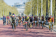"On the Mall. The Tweed Run 2015 - it's 7th annual British public bicycle ride through London's historic streets, with a prerequisite that participants are dressed in their best tweed cycling attire. There are also plenty of handle bar moustaches, penny farthings and Union Jacks. ""Guests can expect a leisurely day cycling, stopping at some of London's most iconic landmarks to enjoy a spot of tea, a picnic in the park and finally a jolly good knees-up in a beautiful art-deco ballroom for the Tweed Run closing ceremony. Starting at Trafalgar Square, the cyclists then embarked on a 12 mile scenic ride through London, stopping at traditional spots."