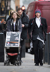 © Licensed to London News Pictures. 29/11/2017. London, UK. Lauri Love (R) arrives with his partner Sylvia Mann pushing a giant speaker at the High Court. Mr Love is appealing extradition to the US over alleged cyber-hacking. Photo credit: Peter Macdiarmid/LNP