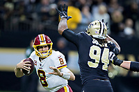NEW ORLEANS, LA - NOVEMBER 19:  Kirk Cousins #8 of the Washington Redskins tries to avoid the rush of Cameron Jordan #94 of the New Orleans at Mercedes-Benz Superdome on November 19, 2017 in New Orleans, Louisiana.  Saints defeated the Redskins 34-31.  (Photo by Wesley Hitt/Getty Images) *** Local Caption *** Kirk Cousins; Cameron Jordan
