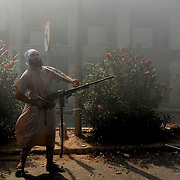 A rebel fighter prepares to shoot against enemy sniper positions in central Zawiya.