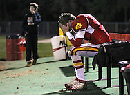Marion's Trevor Hardman (7) sits alone on the bench after a failed fourth down conversion attempt in the closing seconds of their second round playoff football game at Thomas Park Field in Marion on Monday, October 29, 2012.