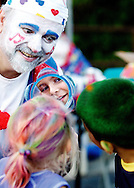 "The Clown ""Notes"" who was coloring kids hair, shows Samantha Bloom and Jacob Angio their new dos during the North Riverside's North Riverside Day at Village Commons in North Riverside, IL.."