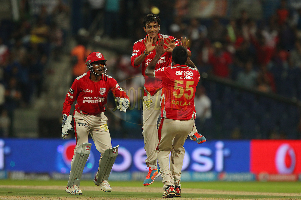 Akshar Patel of the Kings X1 Punjab celebrates the wicket of Piyush Chawla of the Kolkata Knight Riders with Lakshmipathy Balaji of the Kings X1 Punjab  and Wriddhiman Saha of the Kings X1 Punjab during match 15 of the Pepsi Indian Premier League 2014 Season between The Kings XI Punjab and the Kolkata Knight Riders held at the Sheikh Zayed Stadium, Abu Dhabi, United Arab Emirates on the 26th April 2014<br /> <br /> Photo by Ron Gaunt / IPL / SPORTZPICS