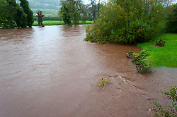 © Licensed to London News Pictures. 26/10/2019. Crickhowell, Powys, Wales, UK. Rain continues to fall as the river Usk breaks it's banks at Crickhowell in Powys. The river level of the Usk is forecast to rise. Photo credit: Graham M. Lawrence/LNP