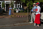 As the Coronavirus lockdown continues over the May Bank Holiday, the nation commemorates the 75th anniversary of VE Day (Victory in Europe Day, the day that Germany officially surrendered in 1945) and in Dulwich, neighbours and residents emerge from their homes to party while still observing social distancing rules. Local residents sing the wartime morale-raising songs of Dame Vera Lynn: 'White Cliffs of Dover' and 'We'll Meet Again', on 8th May 2020, in London, England.