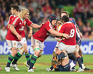 Justin Tipuric (Lions) assists Toby Faletau (Lions) during the tour match of the 2013 British And Irish Lions Australian Tour between RaboDirect Melbourne Rebels vs British And Irish Lions at AAMI Park, Melbourne, Victoria, Australia. 25/06/0213. Photo By Lucas Wroe