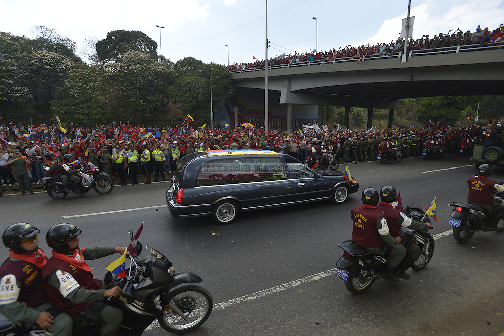 "CARACAS - MARCH 15, 2012: Thousands of people followed the funeral procession on the streets of the city carrying the remains of Venezuelan President Hugo Chavez who died past March 5 after fight against cancer lasted two years. His remains will be buried in Military Historical Museum, today called Cuartel de la Montaña, in the working-class neighborhood ""23 de Enero""(Photo by Gregorio Marrero)"