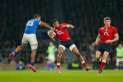 England Winger Anthony Watson is caught by Samoa Outside Centre Reynold Lee-Lo as England Inside Centre Owen Farrell looks on - Photo mandatory by-line: Rogan Thomson/JMP - 07966 386802 - 22/11/2014 - SPORT - RUGBY UNION - London, England - Twickenham Stadium - England v Samoa - QBE Autumn Internationals.
