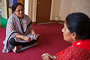 Nepalese social worker, Surja Laxmi, talks with a Nepalese woman at the Voice of Children centre in Kankeshori area of Kathmandu, Nepal. The woman and her daughter have suffered domestic and sexual a.  The not-for-profit organisation supports street children and those who are at risk of sexual abuse through educational and vocational training opportunities, health services and psychosocial counseling.