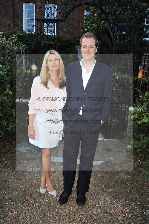 TOM & SARA PARKER BOWLES at a Summer party hosted by Lady Annabel Goldsmith at her home Ormeley Lodge, Ham, Surrey on 14th July 2009.