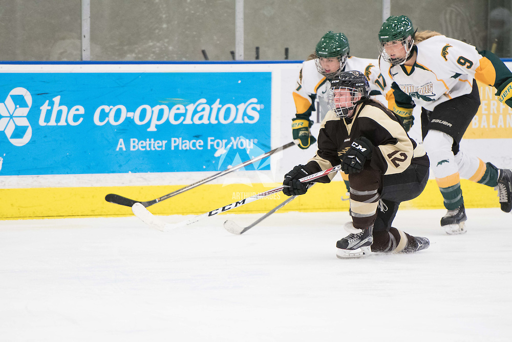 3rd year forward Emma Waldenberger (9) of the Regina Cougars  and 1st year forward Lilla Carpenter-Boesch (17) of the Regina Cougars  in action during the Women's Hockey home game on January 7 at Co-operators arena. Credit: Arthur Ward/Arthur Images