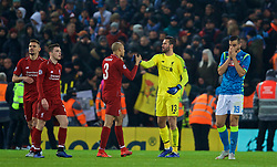 LIVERPOOL, ENGLAND - Tuesday, December 11, 2018: Liverpool's Fabio Henrique Tavares 'Fabinho' celebrates with goalkeeper Alisson Becker after beating SSC Napoli 1-0 and progressing to the knock-out phase during the UEFA Champions League Group C match between Liverpool FC and SSC Napoli at Anfield. (Pic by David Rawcliffe/Propaganda)