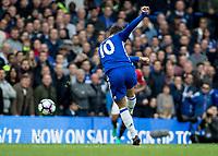 Football - 2016/2017 Premier League - Chelsea V Manchester United<br /> <br /> Rear view of Eden Hazard of Chelsea striking a shot a goal at Stamford Bridge.<br /> <br /> COLORSPORT/DANIEL BEARHAM
