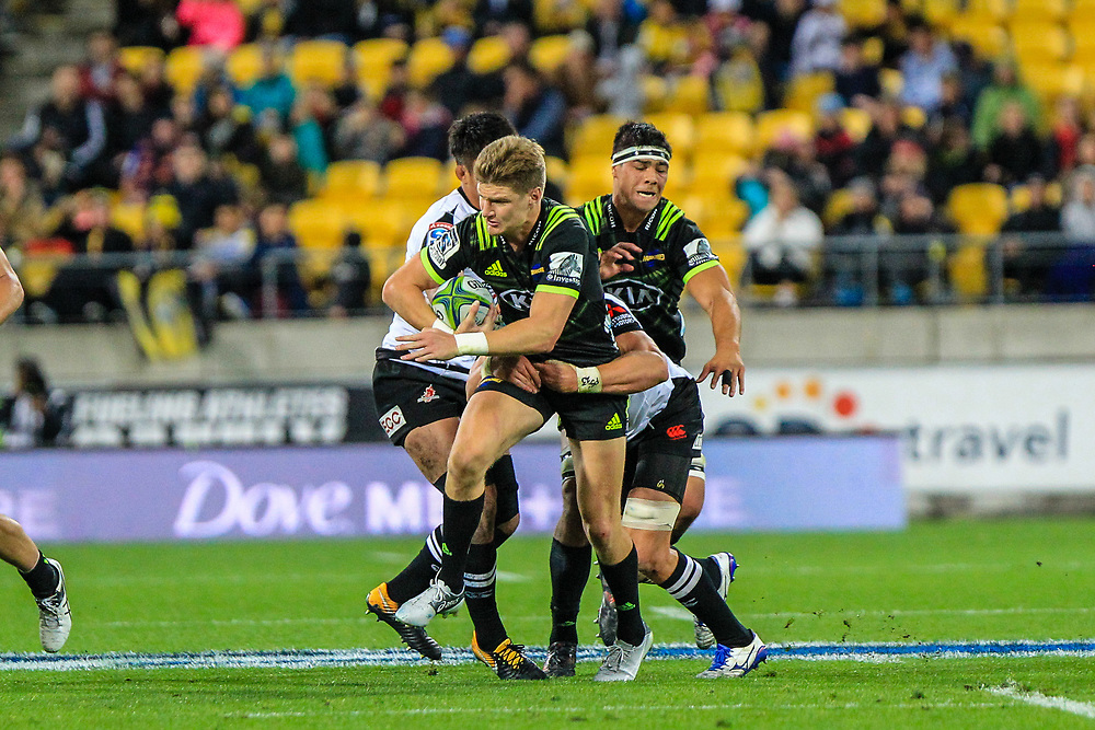 Jordie Barrett tackled during the Super Rugby union game between Hurricanes and Sunwolves, played at Westpac Stadium, Wellington, New Zealand on 27 April 2018.   Hurricanes won 43-15.