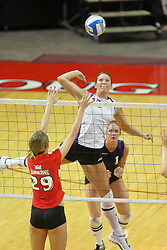 06 October 2007:  Danielle Brazda strikes the ball over the net towards Mallory Leggett. The Illinois State Redbirds pulled out a photo finish in a match that saw the 4th and 5th games extend into extra point play. Northern Iowa Panthers visited the Illinois State Redbirds at Redbird Arena on the campus of Illinois State University in Normal Illinois.