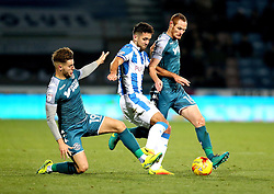 Tommy Smith of Huddersfield Town is tackled by Luke Garbutt and Shaun MacDonald of Wigan Athletic - Mandatory by-line: Robbie Stephenson/JMP - 28/11/2016 - FOOTBALL - The John Smith's Stadium - Huddersfield, England - Huddersfield Town v Wigan Athletic - Sky Bet Championship