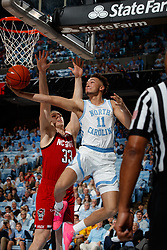 CHAPEL HILL, NC - FEBRUARY 05: Shea Rush #11 of the North Carolina Tar Heels goes to the basket during a game against the North Carolina State Wolfpack on February 05, 2019 at the Dean Smith Center in Chapel Hill, North Carolina. North Carolina won 113-96. North Carolina wore retro uniforms to honor the 50th anniversary of the 1967-69 team. (Photo by Peyton Williams/UNC/Getty Images) *** Local Caption *** Shea Rush