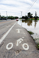 September 13, 2013: The bicycle lane on Alkire Street in Arvada, CO disappears under water as a small creek overflows its banks after record breaking rains hit Colorado over the last few days