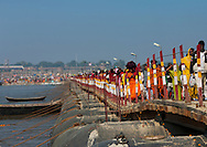 Pilgrims crossing a bridge during Maha Kumbh Mela festival, world's largest congregation of religious pilgrims. Allahabad, India.