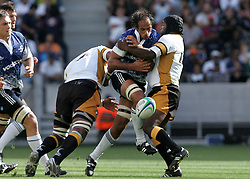 Dylan des Fountain loses the ball forward in the tackle during the Festival of Rugby match between The Boland Cavaliers and The Stormers held at The Cape Town Stadium (formerly Green Point Stadium) in Cape Town, South Africa on 6 February 2010.  This is the first match/event to be held at the new stadium which was purpose built to host matches during the FIFA World Cup South Africa 2010.Photo by: Ron Gaunt/SPORTZPICS