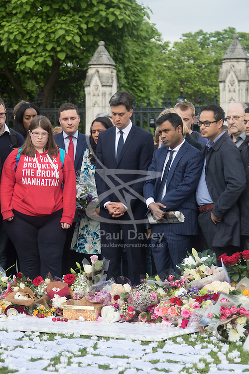 Parliament Square, Westminster, London, June 17th 2016. Following the murder of Jo Cox MP a vigil is held as friends and members of the public lay flowers, light candles and leave notes of condolence and love in Parliament Square, opposite the House of Commons. PICTURED:  Ed Miliband, centre, contemplates.
