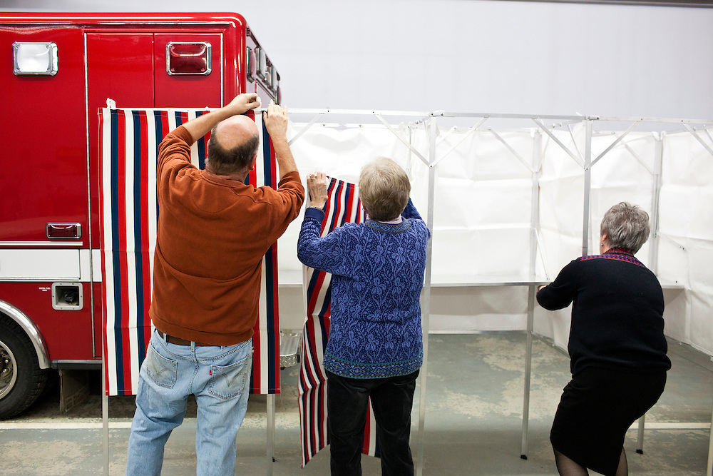 Steve Darrow, Dorothy Campbell, and Bonnie Haubrich, from left, assemble voting booths for primary voting at the Grafton Fire Station on Tuesday, January 10, 2012 in Grafton, NH. Brendan Hoffman for the New York Times