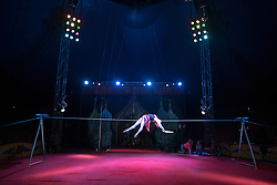 © Licensed to London News Pictures. 22/04/2015. Guildford, UK. Olga Roxhkovskaya, the High Wire Walker shows demonstrates her skills.  Liberal Democrat Kelly-Marie Blundell walks the high wire at Moscow State Circus in Guildford. Photo credit : Stephen Simpson/LNP