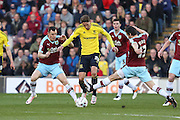Gaston Ramirez of Middlesbrough is tackled by Joey Barton of Burnley during the Sky Bet Championship match between Burnley and Middlesbrough at Turf Moor, Burnley, England on 19 April 2016. Photo by Simon Brady.