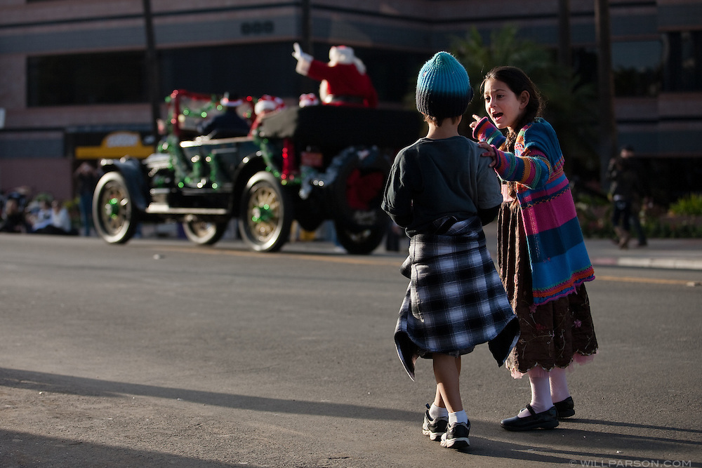 Children watch Santa pass during the La Jolla Christmas Parade.
