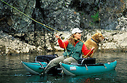 THIS PHOTO IS AVAILABLE FOR WEB DOWNLOAD ONLY. PLEASE CONTACT US FOR A LARGER PHOTO. Idaho. Boise River. Woman and her dog fly fishing on the South Fork.  MR