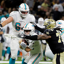 Aug 29, 2019; New Orleans, LA, USA; New Orleans Saints defensive end Ziggy Hood (76) tackles Miami Dolphins quarterback Jake Rudock (5) during a preseason game at the Mercedes-Benz Superdome. Mandatory Credit: Derick E. Hingle-USA TODAY Sports