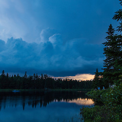 Storm clouds above Durgin Pond in Maine's Northern Forest. Cold Stream watershed, Johnson Mountain Township.