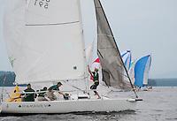Shamrock VI rounds the buoy during Winnipesaukee Yacht Club's J80 race on Thursday evening.   (Karen Bobotas/for the Laconia Daily Sun)