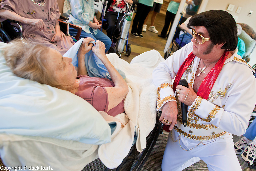 Aug. 2 - PHOENIX, AZ:  DONALD TRAPANI, dressed as Elvis Presley, serenades WANDA DINKINS, at the Stratford, an Alzheimer's care facility in Phoenix. Trapani, 68, was diagnosed with lung cancer in August 2009 and entered the care of Hospice of the Valley, the largest hospice organization in Phoenix, shortly after that. His doctor said he would be dead by the end of February 2010. Trapani is in still in the care of Hospice of the Valley, but his condition has improved. He now entertains other hospice patients singing the songs of Elvis Presley. He tries to hold one concert each week, his health permitting, at different hospice units in the Phoenix area.     Photo by Jack Kurtz