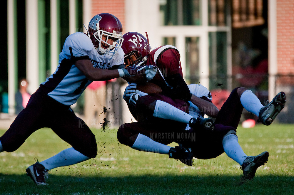 October 10, 2009 - Bronx, NY : Homefield advantage couldn't help the struggling Lions as Riverdale defeated Horace Mann 49-16 on a sunny Clark Field on Saturday afternoon.  Horace Mann's Malcolm Taylor, center, is stopped short by Riverdale's Neil Hamamoto, left, and Alexander Berlinski, right, during a punt return attempt.