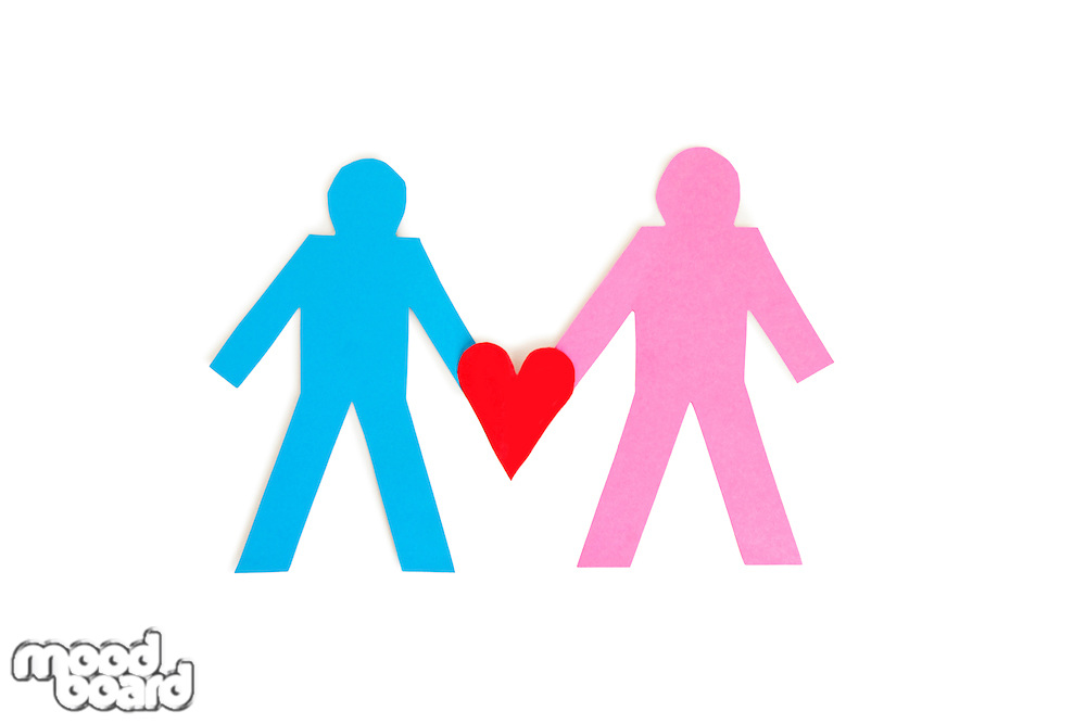 Two stick figures holding a red paper heart over white background