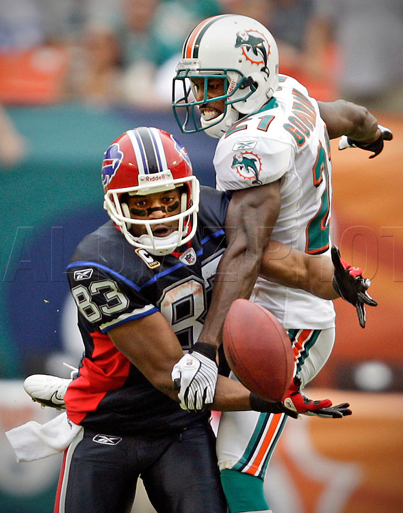 The Bill's Lee Evans losses control of the ball on a pass reception as he is hit by the Dolphin's Andre Goodman late in the fourth quarter as the the Miami Dolphins host the Buffalo Bills at Dolphin Stadium in Miami, Florida on October 25, 2008.